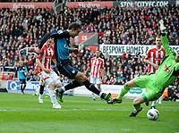 Robin Van Persie Scores goal past Stoke City's Asmir Begovic<br />Arsenal 2011/12<br />Stoke City V Arsenal (1-1) 28/04/12<br />The Premier League<br />Photo: Robin Parker Fotosports International