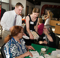 Brady Caldwell and Mikayla Minor serve dessert to Jean and Gina during Laconia High School's Senior / Senior dance Thursday evening at the Huot Center dining room.  (Karen Bobotas/for the Laconia Daily Sun)