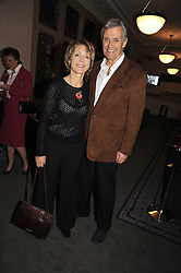 Actor SIMON WILLIAMS and his wife LUCY FLEMING at a party to celebrate the publication of 'Past Imperfect' by Julian Fellowes held at Cadogan Hall, 5 Sloane Terrace, London SW1 on 4th November 2008.