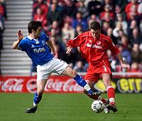 Photo. Glyn Thomas.<br /> Middlesbrough v Birmingham City.<br /> FA Barclaycard Premiership.<br /> Riverside Stadium, Middlesbrough. 20/03/2004.<br /> Matthew Upson (L) battles for the ball with Franck Queudrue.