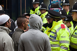 © Licensed to London News Pictures. 29/10/2011. Birmingham, UK. FILE PICTURE DATED 05/09/2009. Police work to keep young Asian men back from an English Defence League demonstration in September 2009. Photo credit : Joel Goodman/LNP