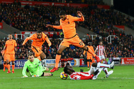 Mame Biram Diouf of Stoke City (on ground)  is fouled just outside the box by Liverpool Goalkeeper Simon Mignolet. Premier league match, Stoke City v Liverpool at the Bet365 Stadium in Stoke on Trent, Staffs on Wednesday 29th November 2017.<br /> pic by Chris Stading, Andrew Orchard sports photography.