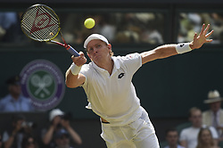 KEVIN ANDERSON BEATS JOHN ISNER AT WIMBLEDON CHAMPIONSHIPS 2018.(180713) -- LONDON, July 13, 2018  Kevin Anderson of South Africa hits a return during the men's singles semi-final match against John Isner of The United States at the Wimbledon Championships 2018 in London, Britain, on July 13, 2018. Kevin Anderson won X-X. (Credit Image: © Stephen Chung/Xinhua via ZUMA Wire)