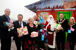 Launching this years Young Peoples Services Annual Toy Appeal at Parkgate Retail Park in Rotherham on Friday are, from left to right: Parkgate Centre Manager Denis Copeland, Parkgate Operations Manager Billy Smith, Family Support Worker RMBC Ann Levick, Dennis McShane MP, and Santa Clause with Mayor of Rotherham Cllr Shaun Wright JP and the  Mayoress of Rotherham Mrs Lisa Wright. 114496-2..11 November 2011. Image © Paul David Drabble