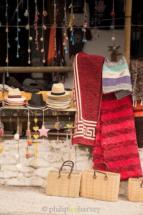 Market stall with hats and clothes, Bubion, Andalusia, Spain