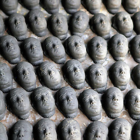 Asia, India, Calcutta. Clay heads and faces  at the potter's village of Kumartuli in Calcutta.