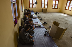October 10, 2018 - Srinagar, Jammu and Kashmir, India - Kashmiri polling officials wait for people to cast their vote in a deserted polling station, during the second phase of municipal polls, in Srinagar, the summer capital of Indian administered Kashmir, India. Poor voter turnout marked the second phase of municipal elections in Kashmir amid a partial shutdown and heavy deployment of government forces across the region  Pro-independence groups have rejected the polls as farce and  called for a boycott while major pro-India parties like National Conference and Peoples Democratic Party (PDP) also stayed away from the electoral process alleging Indian government's attempts to alter the special status accorded to the disputed Himalayan region in the country's Constitution. (Credit Image: © Yawar Nazir/ZUMA Wire)