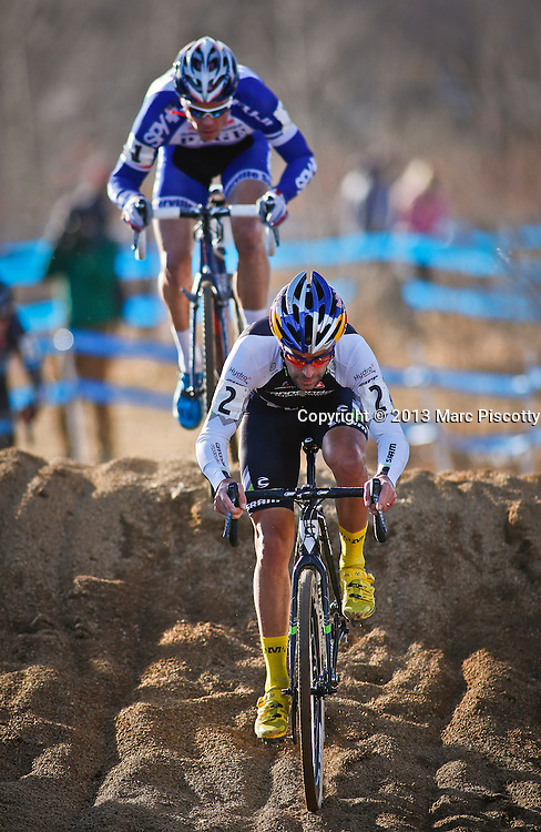 SHOT 1/12/14 3:55:20 PM - Jonathan Page (#1) of Northfield, NH chases Timothy Johnson (#2) of Topsfield, Ma. as the two compete in the Men's Elite race at the 2014 USA Cycling Cyclo-Cross National Championships at Valmont Bike Park in Boulder, Co. Johnson finished third in the race. (Photo by Marc Piscotty / © 2014)