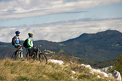two mountain bikers looking at view, Vipava valley, Istria, Slovenia