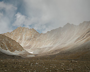 """Mountain scape. Going over the Garumdee Pass (4895m). Guiding and photographing Paul Salopek while trekking with 2 donkeys across the """"Roof of the World"""", through the Afghan Pamir and Hindukush mountains, into Pakistan and the Karakoram mountains of the Greater Western Himalaya."""