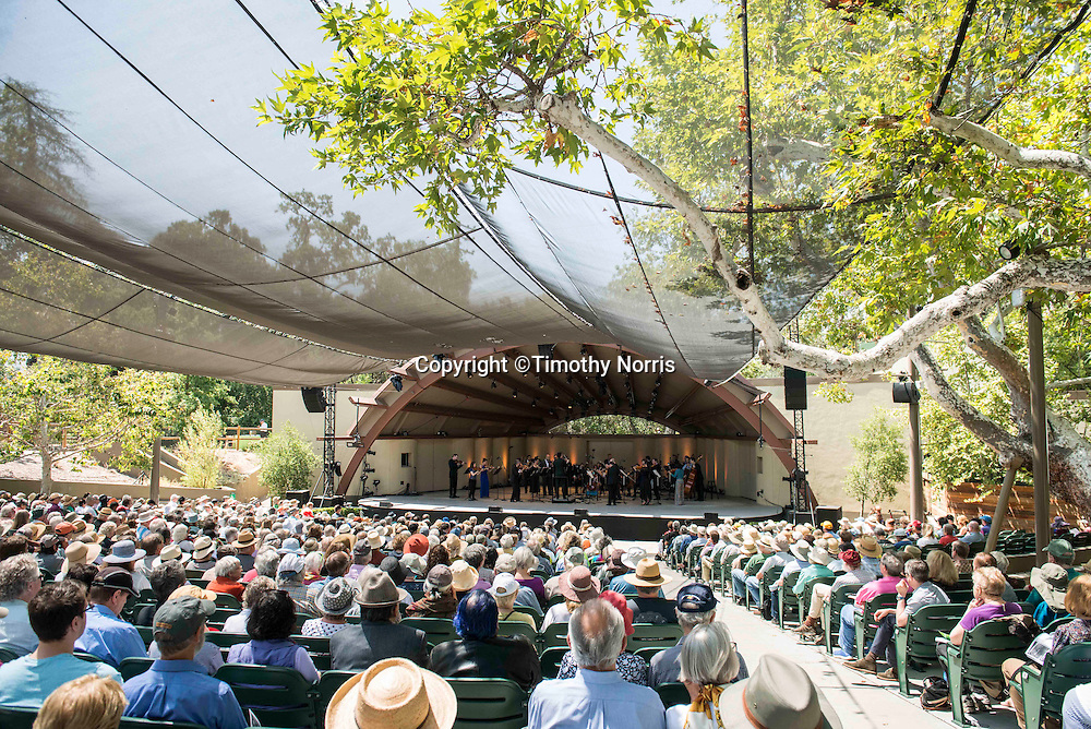 """The Knights, conducted by Eric Jacobsen, perform Mozart's Symphony No. 41, """"Jupiter"""" at the 68th Ojai Music Festival at Libbey Bowl on June 15, 2014 in Ojai, California."""