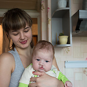 CAPTION: Nina Panteleeyeva lovingly holds her daughter, for whom she and her husband had been trying for three years, close to her chest. Valentina was born 2.5 months ago with a complete unilateral cleft lip and alveolus. LOCATION: Volzhskiy, Volgograd Oblast, Russia. INDIVIDUAL(S) PHOTOGRAPHED: Nina Panteleeyeva (left) and Valentina Panteleeyeva (right).