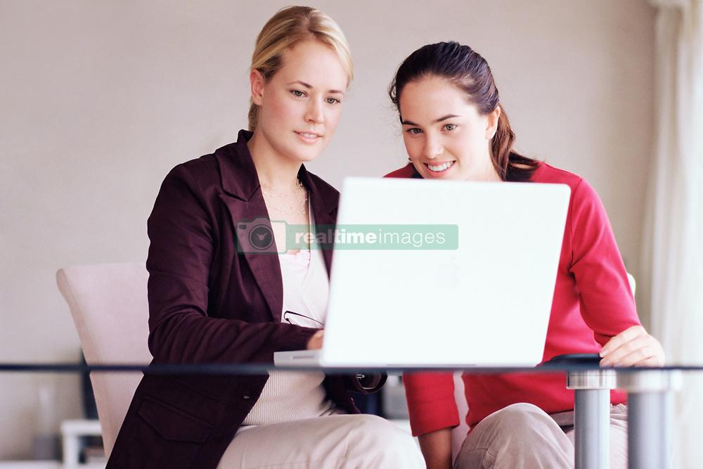 Dec. 14, 2012 - Two women using laptop computer (Credit Image: © Image Source/ZUMAPRESS.com)