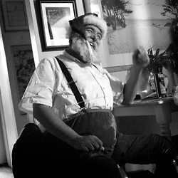 Russell Bissonnette relaxes in his Half Moon Bay apartment after his personal appearance as Santa Claus at the Miramar Beach Restaruant Christmas Party in Half Moon Bay on Monday night, Dec. 20, 2004.<br />