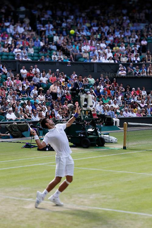 Mcc0032212 . SundayTelegraph..Novak Djokovic vs Marcos Baghdatis, Centre court  on a shift lens...The sixth day of The Lawn Tennis Championships at Wimbledon..24 June 2011 Wimbledon