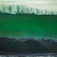 A Pacific Ocean wave breaks at Montara State Beach near San Francisco, California.