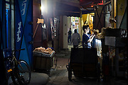 A boy delivers bread to a small store in a narrow market street in Meknes, Morocco on November 1, 2007.