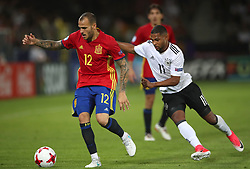 Spain's Ramirez Sandro (left) and Germany's Serge Gnabry battle for the ball