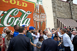 President Barack Obama greets a crowd gathered outside Manuel's Tavern in Atlanta, Ga., March 10, 2015. (Official White House Photo by Pete Souza)<br /> <br /> This official White House photograph is being made available only for publication by news organizations and/or for personal use printing by the subject(s) of the photograph. The photograph may not be manipulated in any way and may not be used in commercial or political materials, advertisements, emails, products, promotions that in any way suggests approval or endorsement of the President, the First Family, or the White House.