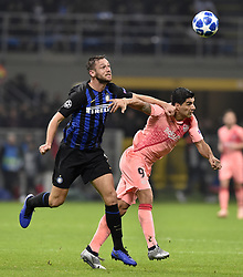 MILAN, Nov. 7, 2018  FC Barcelona's Luis Suarez (R) vies with FC Inter's Stefan de Vrij during the UEFA Champions League Group B match between FC Inter and FC Barcelona in Milan, Italy, on Nov. 6, 2018. The match ended with 1-1 draw. (Credit Image: © Augusto Casasoli/Xinhua via ZUMA Wire)