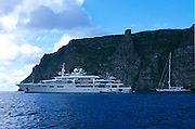 Paul Allen's 302' (92m) Superyacht Tatoosh off the coast of Wolf Island in the Galapagos has two helicopter decks, a 42 sailboat as a tender.  On the right is Hyperion, the finest sailing superyacht in the world.