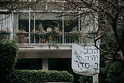 A homemade sign hangs from a balcony stating 'Everything will be OK' in Hebrew as a self support to others during the COVID-19 quarantine. Photographed in Tel Aviv, Israel on April 8th 2020