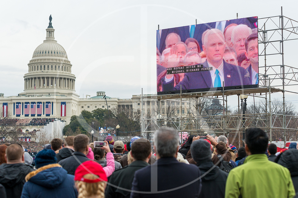 Washington DC, United States - VP-elect Michael Pence is sworn in by Supreme Court Justice Clarence Thomas during the 2017 inauguration ceremony for Donald J. Trump.