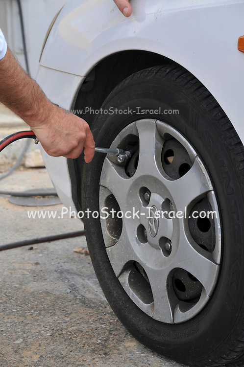 Inflating a car tyre