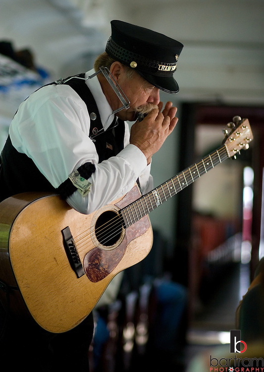 Greg Schindel performs as the Train Singer aboard the California Western Railroad's Skunk Train near Fort Bragg, California on Saturday, June 30, 2007. The old steam powered train travels from the Pacific Coast through the redwood forest of Northern California.