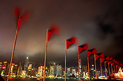 Flags of the Swire Group of companies flutter in Monsoonal winds on the night of the Handover of sovereignty from Britain to China, on 30th June 1997, in Hong Kong, China. Midnight signified the end of British rule, and the transfer of legal and financial authority back to China. Hong Kong was once known as fragrant harbour or Heung Keung because of the smell of transported sandal wood.