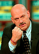 Minnesota Gov. Jesse Ventura, a former pro-wrestler holds up his fist during the Sunday political talk show Meet the Press on NBC Television February 21, 1999 in Washington, DC.