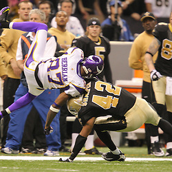 Jan 24, 2010; New Orleans, LA, USA; New Orleans Saints safety Darren Sharper (42) hits Minnesota Vikings wide receiver Bernard Berrian (87) during a 31-28 overtime victory by the New Orleans Saints over the Minnesota Vikings in the 2010 NFC Championship game at the Louisiana Superdome. Mandatory Credit: Derick E. Hingle-US PRESSWIRE