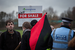 © Licensed to London News Pictures . 27/11/2013 . Manchester , UK . Protesters at the site . Energy firm IGas have today (Wednesday 27th November 2013) been receiving drilling equipment in readiness for exploratory drilling at the site . Anti fracking protesters have established a camp at Barton Moss in Greater Manchester alongside an access road leading to an IGas drilling site .  Photo credit : Joel Goodman/LNP