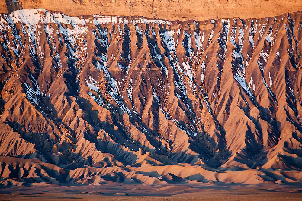 Detail of Factory Butte and mancos shale formation at sunrise, Utah.