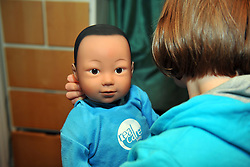 13 year old girl minds a 'real care baby' for the weekend as part of a school project to prevent teenage pregnancy.  The baby needs real care and is monitored by computer to check the progress and to make the situation realistic. MR