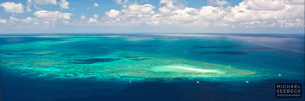 An aerial view of Sudbury Cay and adjoining reef, Great Barrier Reef<br /> <br /> Open Edition Print