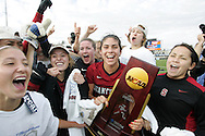 04 December 2011: Stanford's Alina Garciamendez (in red) holds the championship trophy while celebrating with her teammates. The Stanford University Cardinal defeated the Duke University Blue Devils 1-0 at KSU Soccer Stadium in Kennesaw, Georgia in the NCAA Division I Women's Soccer College Cup Final.