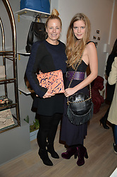 Left to right, ASTRID HARBORD and KATIE READMAN at a party hosted by Melissa Del Bono to celebrate the launch of her Meli Melo flagship store at 324 Portobello Road, London W10 on 28th November 2013.