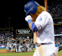 November 1, 2017 - Los Angeles, CA, USA - Los Angeles Dodgers' Justin Turner walks off the field as the Houston Astros celebrates as they defeat the Los Angeles Dodgers 5-1 in game seven of a World Series baseball game at Dodger Stadium on Nov. 1, 2017 in Los Angeles. (Credit Image: © Keith Birmingham/Los Angeles Daily News via ZUMA Wire)