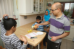Asian family in kitchen.