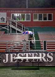 24 June 2015. New Orleans, Louisiana.<br /> National Premier Soccer League. NPSL. <br /> Jesters 0 - Atlanta Silverbacks 1.<br /> The New Orleans Jesters lose 0-1 to the Atlanta Silverbacks in a lightning delayed game at home in the Pan American Stadium. Lady in a Union Jack umbrella leaves the stands at the end of the game.<br /> Photo©; Charlie Varley/varleypix.com