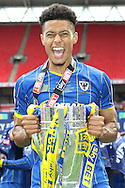 Lyle Taylor forward for AFC Wimbledon (33). AFC Wimbledon promotion to League One, after beating Plymouth Argyle Football Club 2-0 during the Sky Bet League 2 play off final match between AFC Wimbledon and Plymouth Argyle at Wembley Stadium, London, England on 30 May 2016. Photo by Stuart Butcher.
