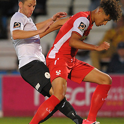 TELFORD COPYRIGHT MIKE SHERIDAN Aaron Williams battles for the ball with Rhys Williams of Kidderminster during the National League North fixture between AFC Telford United and Kidderminster Harriers on Tuesday, August 6, 2019.<br /> <br /> Picture credit: Mike Sheridan<br /> <br /> MS201920-006