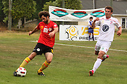competes against Waikato's Jack Beguely defends the ball from Waitakere United Allan Pearce for the ball. NZFC, ASB Premiership football match, Waikato FC v Waitakere United at Fred Jones Park, Hamilton, New Zealand. Saturday 11 December 2010. Photo: Dion Mellow / photosport.co.nz