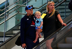 England's Joe Root with his son Alfred and fiancée Carrie Cotterell as the team arrive at Adelaide Airport.