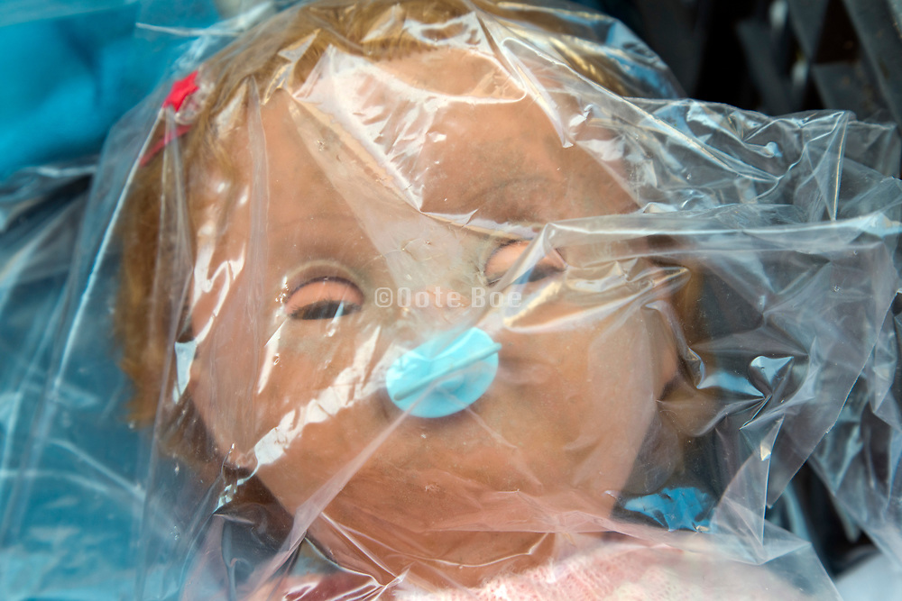 doll in clear plastic bag