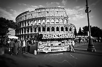Black and white photo of a gelato stand outside of the Colosseum in Rome, Italy.