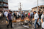 Residents in Reyhanli, Turkey stand and look at the destruction caused by two car bombs in Reyhanli, on Turkey's border with Syria. 46 people are said to have died, and anti-Syrian sentiment is growing
