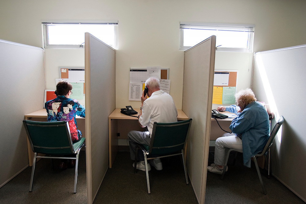 Mary Fenton, left, Barry Greenberg, center, and Peggy Mullin, right, volunteer as Fraud Fighters at the WISE and Healthy Aging facility in Santa Monica, CA where they phone senior citizens to warn them of phone fraud.