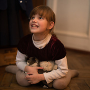 """CAPTION: Though Maya loves to play with her soft toys, she is happiest when with her cat, Kostya, who she loves very much. """"When she was little"""", Maya says, """"she would bite me. So I would bite back, but would spit out her fur... not tasty! Now we are sisters and best friends; my cat always listens to me"""". LOCATION: St Petersburg, Russia. INDIVIDUAL(S) PHOTOGRAPHED: Maya Kurenkov."""